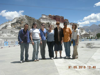 Tibet Tour Organizer Tony and his Clients in front of Potala Palace